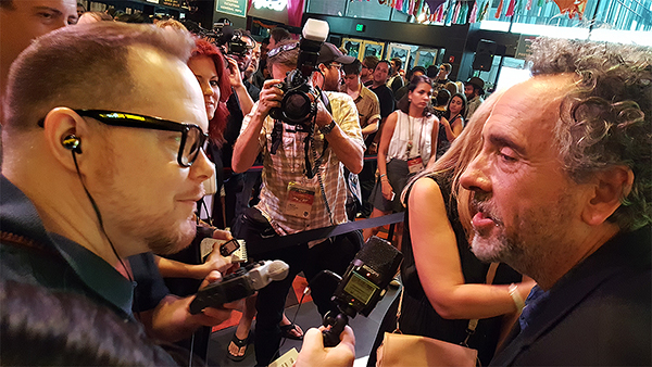Patrick Phillips speaks with Tim Burton on the red carpet at Fantastic Fest